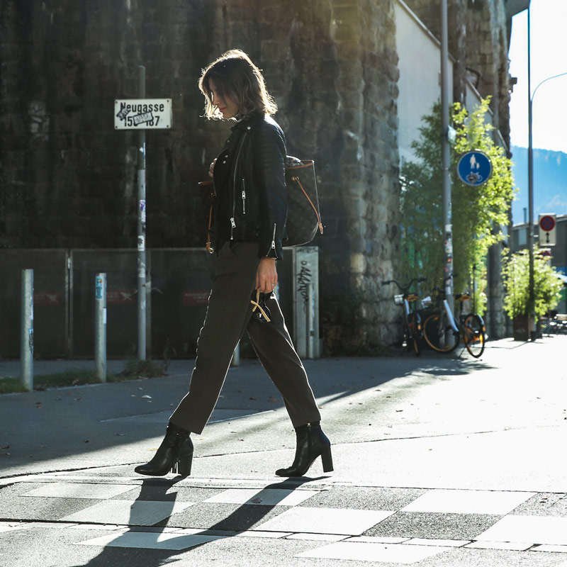 sonrisa walking in the sun wearing a leather jacket picture by Jehona Abrashi