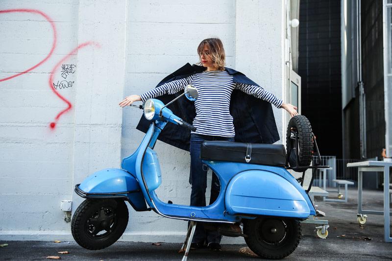 sonrisa posing with blue Vespa