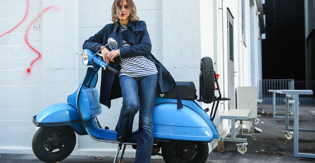 sonrisa posing with blue Vespa